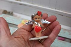 Imagine the tiny places this little cupid could go. Such mischief with that arrow..