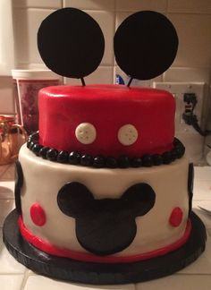 Mickey Mouse Cake. Classic white cake with strawberry filling with butter cream frosting, decorated with homemade fondant
