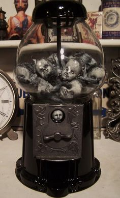A Gothic Gumball Machine....I have to make this for B... she will love it.. now to find a gumball machine ... and be able to keep this creepy thing in my house.... eeeeeeeekkkk