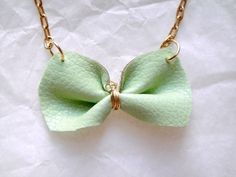Bright Leather Jewelry Mint Green Bow Necklace. $25.00, via Etsy.