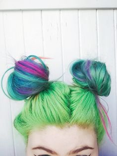 Rainbow hair with turquoise, purple and green space buns