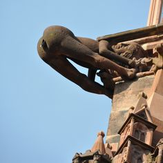 """""""Defecating person"""" Gargoyle - south side Cathedral of Our Lady (Münster)  Altstadt, Freiburg im Breisgau, Germany"""