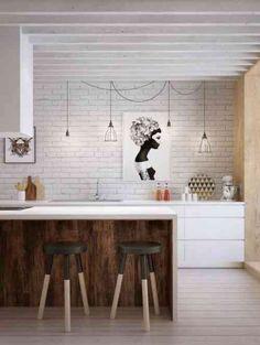 petite cuisine blanche avec ilot central