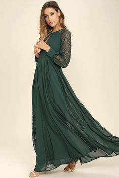 Put on your flower crown and the Field of Dreams Forest Green Lace Maxi Dress and let the magic begin! A mock neck (with double button closure) and keyhole cutout, top a seamed bodice and set-in waist, framed by long sleeves with sheer lace panels and buttoned cuffs. Full maxi skirt features flaring sheer lace godets.  Hidden Back zipper.