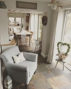 We love the look of this neutral, bright and pure kitchen/living space. The casual comfort of the arm chair contrasts perfectly with the formal dining area. My Living Room, Home And Living, Living Room Decor, Living Spaces, Kitchen Living, Küchen Design, House Design, Interior Design, Cottage Shabby Chic