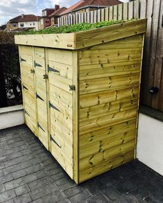 A Bluum Bin Store, hand made from smooth planed, pressure treated timber. This bin storage solution enables the user to store and easily access two wheelie bins, two recycling boxes and a food caddy. All whilst keeping the garden and driveway looking neat and tidy - and showcasing the store with the planter roof. The contents are kept snug and dry under the unique Bluum living green roof area, featuring a sedum blanket to give instant green vegetation.