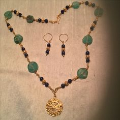 As I noted I love Roman glass. This is another sample of reproduction Roman jewelry I made with Roman glass beads.