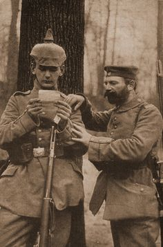 WW1: German father and son reading a letter on the battlefield near Rheims.