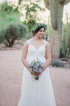 Boho-chic bride wedding dress idea - lace gown with sweetheart neck cap sleeves + flower crown {Candid Moments Photography}