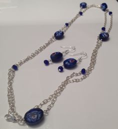 Blue glass bead necklace and earrings $40