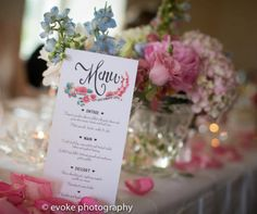 Bridal table of mixed crystal vase's and scattered petals