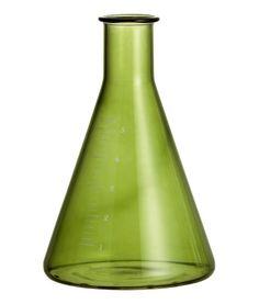 Kleine kegelförmige Glasvase mit Druck. Durchmesser oben 2 cm, Höhe 10 cm.