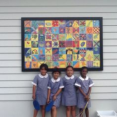 Students in front of hand painted tile mural  Paint & Create