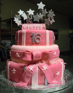 Fondant covered cake with fondant ribbon, sugar sparkles and fondant star accents