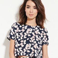 Navy Blue Floral Print Top Navy Blue with white and pink leafs printed top. Has zipper on back neck. Size small. New with tag. Tops