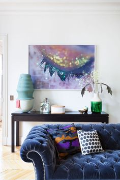 Playful photography, Chesterfield sofa in unexpected blue velvet & a colorful camouflage cushion