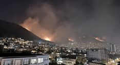 Firefighters are battling a blaze which has engulfed Lions Head and Signal Hill in Cape Town – here's how you can help. Signal Hill, Firefighters, Cape Town, Airplane View, Paris Skyline, Battle, Canning, Travel, Firemen