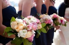 I love the navy dresses with the blush pinks, the pale oranges, and creams!
