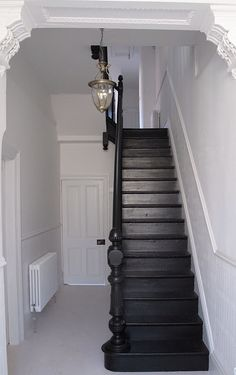 Explore The Best 24 Painted Stairs Ideas for Your New Home : 27 Painted Staircase Ideas Which Make Your Stairs Look New Tags: painted staircase, painted plywood stairs, painted stairs black, painted stairs ideas pictures Black Staircase, Staircase Design, Staircase Ideas, Black Banister, Staircase Remodel, Hallway Ideas, Painted Staircases, Staircase Painting, Hallway Inspiration