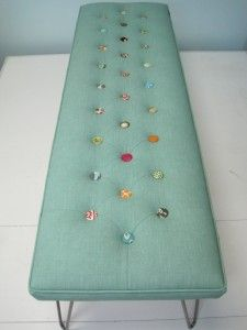 Pretty- Idea for recovering ottoman: use solid color for main fabric but use scraps from various curtains and pillows for button covers