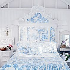 Love this headboard! Repeat a pattern on multiple applications for maximum impact. A large-scale print in a light blue and white looks dramatic and graphic but still pretty and inviting.