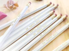 """White with Gold Pencil stamped with """"Oh Happy Day"""" by Earmark"""
