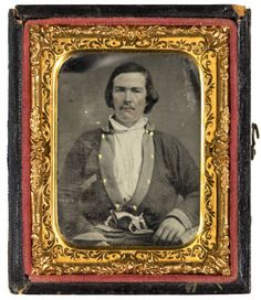 Portrait of Private William Burgess, Company D, 27th Texas Cavalry Regiment, Whitfield's Legion, Confederate States Army, with gold uniform buttons and revolver in belt. This ambrotype was one of 65 cased tintypes or ambrotypes that were 'found' by a Union soldier at the Confederate 'dead letter' office at Richmond, Virginia at the end of the war. The photographs remained 'lost' until they appeared in a public auction in 1991. Source: Lawrence T. Jones III.