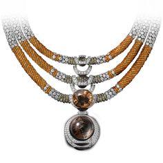 High Jewelry necklace White gold, one 21.13-carat cushion-shaped orange tourmaline, one cabochon-cut rutilated quartz, mandarin garnet beads...
