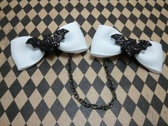 Rockabilly, Psychobilly, Pin Up Girl,  Black Bow Sweater Clips with Glitter Bat Accents. $20.00, via Etsy.