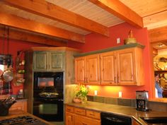 OK the green stain isn't that bad, I guess.  But I love the warm wood cabinets, the tile backsplash that goes with the countertop, and the reddish orange walls