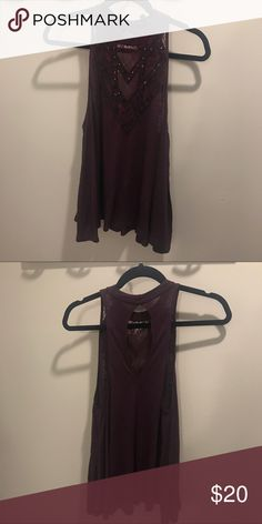 Express Purple high neck top Beading and mesh at the top to create an illusion neck. Color is plum. In great condition. Express Tops Tank Tops