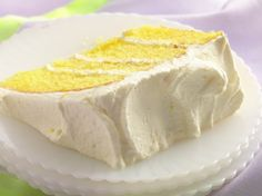 Lemon Velvet Cream Cake Recipe ~ Whipped cream and cream cheese create a dreamy frosting and filling for a mix-easy lemon cake!