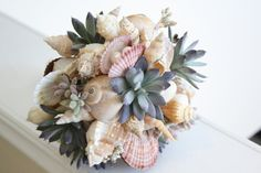 MERMAIDS DELIGHT.beach wedding bouquet and boutonniere set shell and Succulent via Etsy