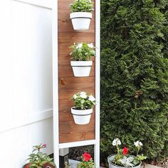 This cute, DIY vertical planter stand is adding lots of summertime charm to our backyard patio! It can be used as a vertical garden or herb garden! And it's great for extra privacy too! The free build plans are up on the blog!