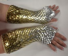 Frosted silver fades into champagne, then gold, then bronze colored anodized aluminum scales in these subtle yet mesmerizing gauntlets. The scales