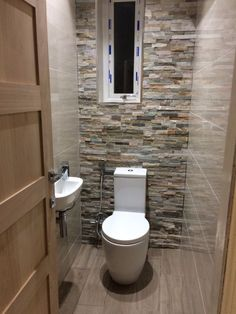 love this splitface tiles in a small wc (but now I've realised the window isn't central to the wall it bothers me!!)
