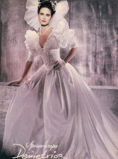 Typical example of the excesses--especially in bridal wear--of the 1980's.  This is actually one of the better designs, if it were scaled down somewhat.