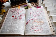 Guests were instructed to choose a word that described the bride and groom in a dictionary, and sign their signature next to it - Photo by: Nancy Cohn Photography; Wedding planner: Heather Lowenthal