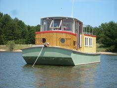 Small Houseboats | Saugatuck Wooden Boat Cruises tours charters.  Captain Christopher Carr kalamazoo michigan