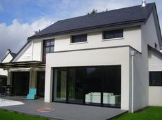 Agrandissement de maison en ossature bois avec toit plat for Agrandissement maison 77
