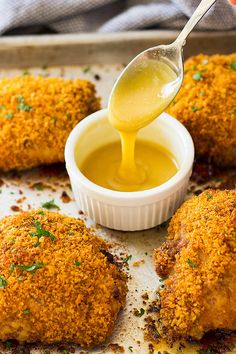 These Crispy Oven Fried Chicken Thighs are made crispy with a special ingredient! And the honey mustard sauce puts them over the top!