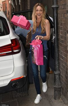 Time to celebrate! Storm Keating, 34, was pictured carrying birthday presents in to the Olympia Theatre for her husband Ronan's daughter Ali on Wednesday