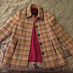 Coach wool pea coat Absolutely gorgeous multi colored Coach wool jacket. Hot pink lining with signature C pattern. Leather trim and brown tortoise shell buttons. Very warm and super cute. I am sad to part with it, but just haven't worn enough to keep. Coach Jackets & Coats Pea Coats