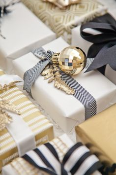 Black, white, and gold wrapping! Love the idea of using ornaments for gift wrapping!