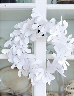 paper mistletoe wreath--cut out 50 mistletoe templates, arrange and glue onto a cardboard wreath. cute!