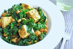 Quick Curried Chickpeas with Tofu and Kale - kale, olive oil, white onion, garlic cloves, toasted cumin seeds, ground turmeric, garam masala, chickpeas, roma tomatoes, extra-firm tofu, salt & ground pepper
