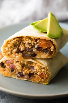 These freezer cauliflower rice black bean burritos are lighter but just as tasty! Loaded with veggies, salsa, black beans and cheese, and so convenient to have stocked in your freezer.