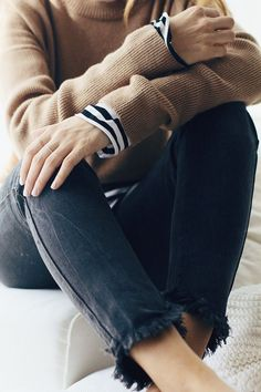 black + white + camel = fav color combo. love the layering with the stripes peeking through; not a fan of the frayed bottom of the jeans, but I do like the black color