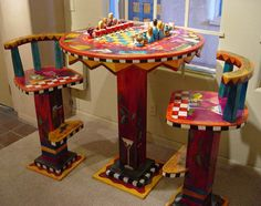 Fine art furniture at Lanning Gallery in Sedona Arizona includes tables, chairs and accessories hand made with inlaid woods in a variety of colorful, exclusive designs.