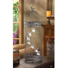 Birdcage Staircase Candle Stand (Item A little bird sits atop this darling cage that houses spiral stair-stepped tealight candle cups. Birdcage door provides easy access to the candles. diameter x high. Iron and glass. Candles not included. Candle Cups, Tealight Candle Holders, Candle Lanterns, Tea Light Candles, Tea Lights, Candleholders, Glass Candle, Candle Stands, Candle Lighting